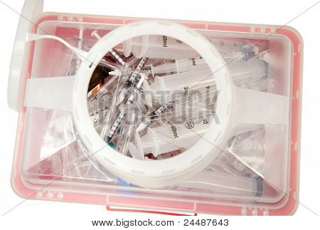 Syringes and pipets in a sharps container.