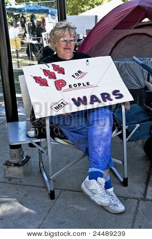 A Woman Holds Protest Sign at Occupy L.A.