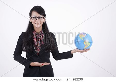 Pretty Business Woman  Holds A Globe