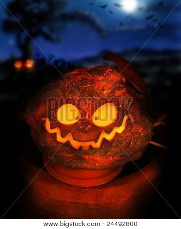 Spooky Halloween image of a glowing jackolantern with eerie night sky in background including moon and bats