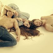 Love Triangle. Erotic, Desire Concept. Machos Sleep With Bare Muscle Torsos. Woman With Men Relax On poster
