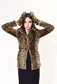 Woman In Leopard Fur Coat Isolated On White. Leopard Fur At Stylish Girl. Fur Coat Boutique With Nat poster