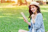 Asian Teen Smile To Write Note Script Letter At The Park poster