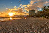 Beautiful Sunset At Waikiki Beach In Oahu. Waikiki Beach, South Shore, Is Neighborhood Of Honolulu A poster