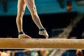 Artistic Gymnastics Legs Women Gymnast Exercises On Balance Beam poster