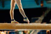 Artistic Gymnastics Legs Women Gymnast Exercises On Balance Beam poster