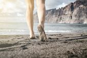 Woman Barefoot Walking On A Beach, Summer Inspiration. Female Naked Legs Running, Walking Or Jogging poster