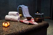 Spa And Wellness Setting With Rolled Spa Towels, Candles And Aroma Oil  In A Sauna Room poster