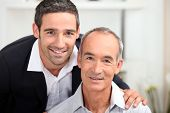 stock photo of 55-60 years old  - portrait of father and son - JPG