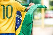 Brazilian Boy Holding The Flag Of Brazil poster
