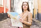 Female Traveler With Map. Woman Traveling. Determined And Confident Person Exploring The World. Free poster