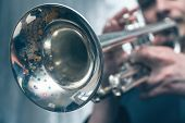 The Trumpeter Is Playing On A Silver Trumpet. Trumpet Player poster