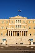 image of evzon  - This is a view of constitution (Syntagma) square in Greece with the Parliament Building and the evzones in front of the tomb of the unknown soldiers