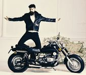 Hipster Biker Brutal In Leather Jacket On Motorcycle Enjoying Richness. Superiority Concept. Man, Be poster