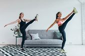 Fit Woman Stretching Legs Warming Up Workout At Home. poster