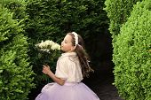 Girl With Flowers. Girl Child In Green Summer Park, Spring. Wedding Fashion, Beauty Salon. Bride Gir poster