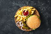 Burger, Hamburger Or Cheeseburger Served With French Fries, Pickles And Onion On Wooden Board. Top V poster