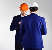 People In Helmets Isolated On White Background. Architects Think About Project. Construction, Busine poster