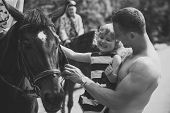 Family Holiday. Equine Therapy, Recreation Concept. Girl With Man Pet Horse On Sunny Day. Child With poster