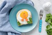 Creative Food Art Breakfast Idea For Kids. Chicken Shaped Toast On A Blue Plate, Meal For Kids. Chil poster
