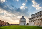 Dramatic sunset over the Piazza dei Miracoli (Piazza del Duomo) with medieval round Romanesque Bapti poster