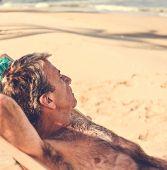Senior man chilling on the beach poster