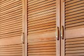 Modern Wooden Cabinet In Classic Rustic Style. Details Of Wardrobe Case With Shutter Plank Doors. Co poster