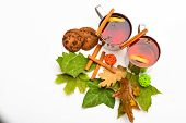 Mugs With Mulled Wine Or Hot Drink Near Autumn Leaves And Cookies On White Background, Close Up. Hot poster
