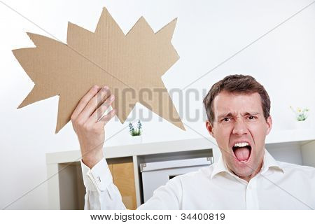 Angry man screaming with speech balloon in his office