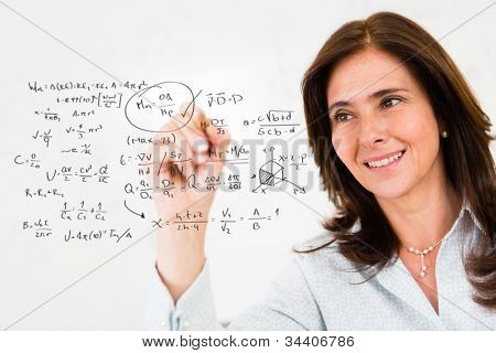 Female teacher wiriting math formulas - education portrait