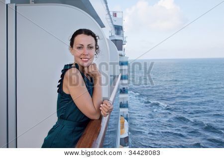 young smiling woman traveling on ship