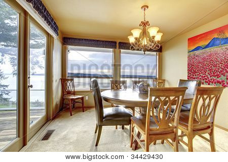 Dining Room With Water View And Large Windwos And Doors.