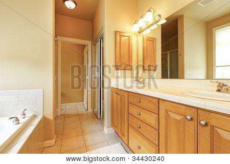 Large Beige And Wood Bathroom Interior.