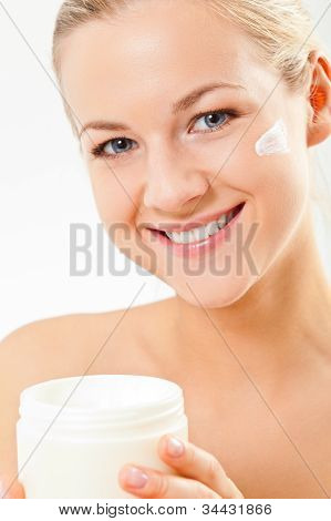 closeup blond woman portrait with cream