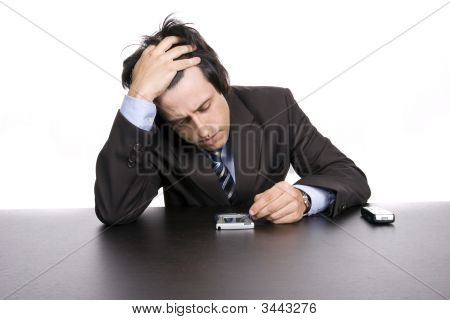 Young Worried Businessman, Working With Pda