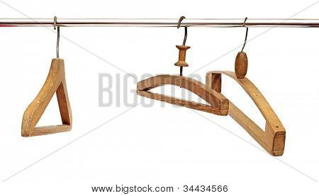 Three coat hangers on a clothes rail
