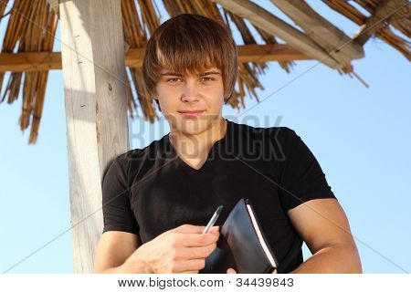 Handsome Young Man With Writing Pad, Outdoors