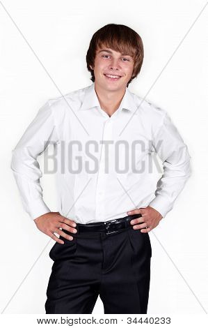 Happy Stylish Young Man Standing With Hands In Pockets Over White Background