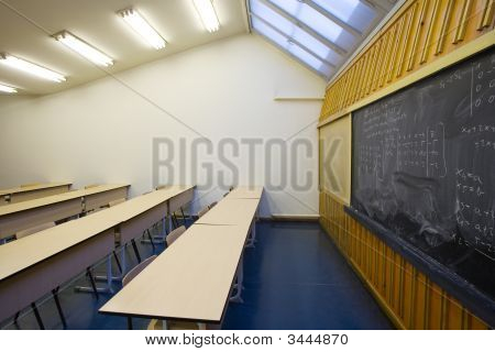 Empty Desks And Chairs In A School Classroom