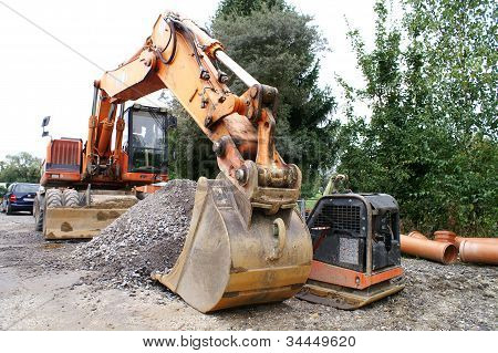 Excavator Working At The Construction Site