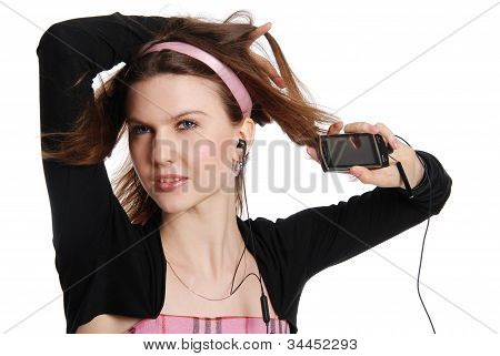 The Girl With A Cellular Telephone Listens To Music In Ear-phone