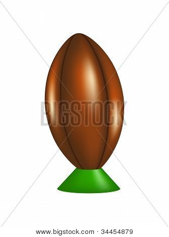 Retro rugby ball on kicking tee