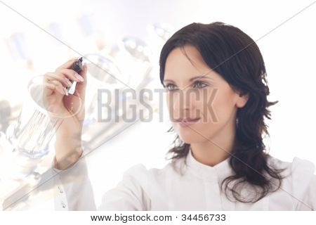 Businesswoman Making A Drawing Of A Technology Scetch