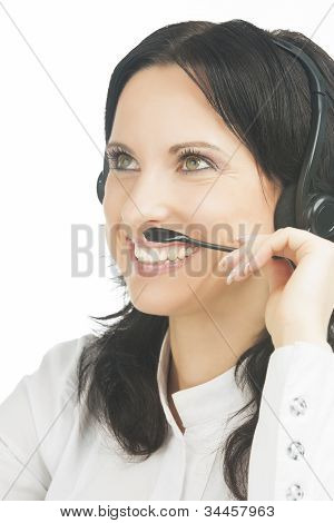 Closeup Portrait Of Smiling Brunette Call-center Customer's Support Operator With Headset Isolated O