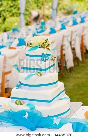 Wedding Cake And Table Setting Outdoors