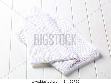 White folded napkin on a white kitchen table