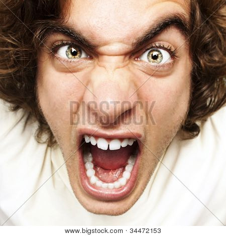 portrait of a furious young man shouting