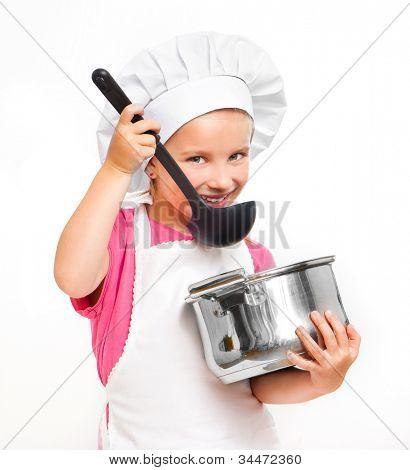 hermosa niña con un pan y el cucharón aislado en blanco