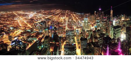 Chicago downtown aerial panorama view at night with skyscrapers and city skyline at Michigan lakefront.