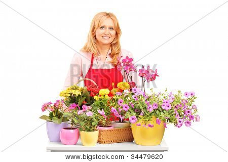 A mature female florist and flowers isolated on white background